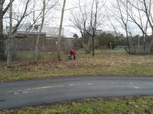A volunteer tracks down some trash.